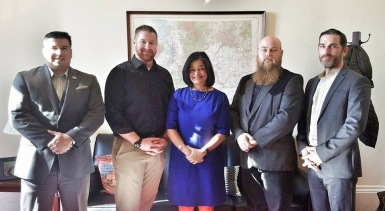 Casler, Far Right, with Rep. Pramila Jayapal (WA)